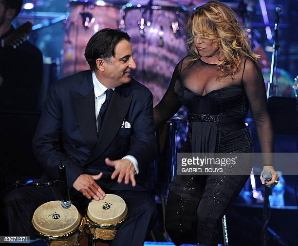 Actor Andy Garcia plays congas with singer Ednita Nazario during the 2008 Latin Recording Academy Person of the Year awards tribute to Gloria Estefan...