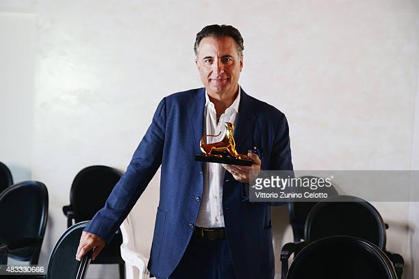 Actor Andy Garcia poses with the Leopard Club Award 2015 on August 7 2015 in Locarno Switzerland