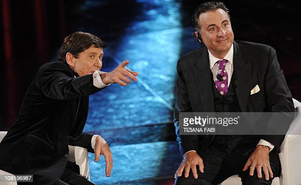 US actor Andy Garcia speaks with Gianni Morandi during the 61th Italian Music Festival on the stage of the Ariston Theatre in San Remo on February 16...