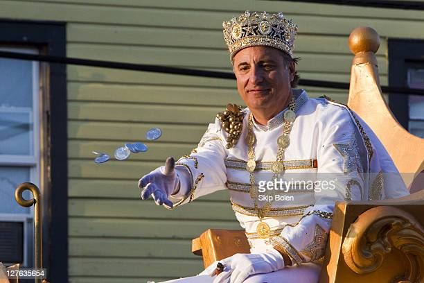 Actor Andy Garcia tosses Mardi Gras doubloons to his fans as he reigns as King of Bacchus in the 2011 Krewe Of Bacchus XLIII Parade on March 6 2011...