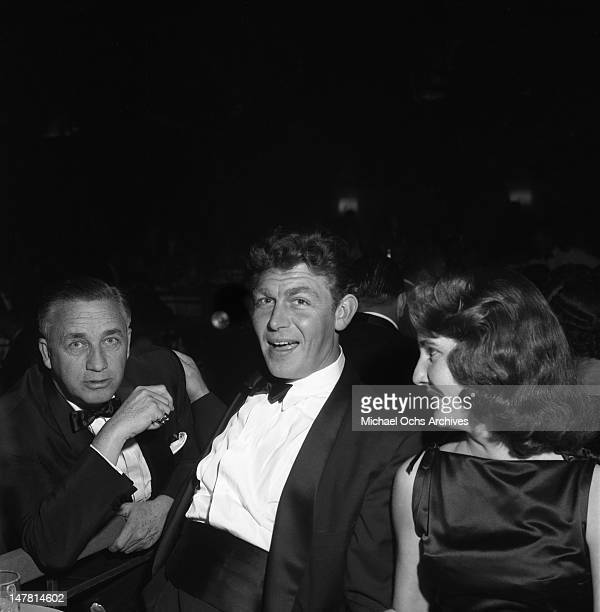 Actor Andy Griffith poses for a photo with his wife Barbara and producer/director Mervyn LeRoy at the Screen Directors Dinner on February 2 1957 in...