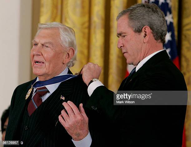 Actor Andy Griffith recieves the Medal of Freedom from US President George W Bush during a ceremony at the White House November 9 2005 in Washington...