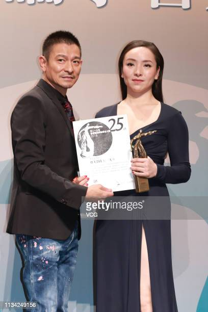 Actor Andy Lau Takwah presents trophy to actress Chloe Maayan during the 25th Hong Kong Film Critics Society Awards Ceremony on March 7 2019 in Hong...