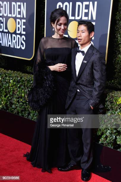 Actor Angelina Jolie and Pax Thien JoliePitt attends The 75th Annual Golden Globe Awards at The Beverly Hilton Hotel on January 7 2018 in Beverly...