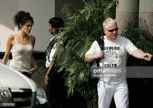 US actor Angelina Jolie is escorted by her bodyguard on location during a film shoot in Mumbai 13 November 2006 Jolie is in Mumbai to shoot for her...