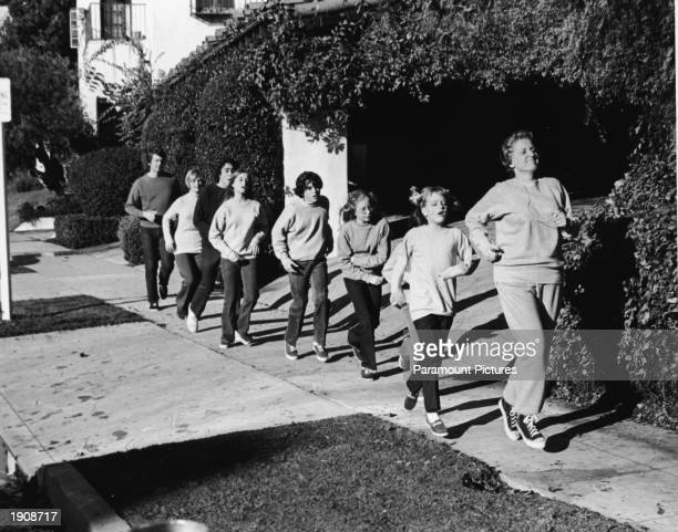 Actor Ann B Davis leads the Brady family in a rigorous jog in a still from the television series 'The Brady Bunch' 1972 Robert Reed Florence...