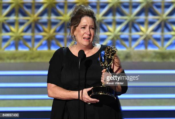 """Actor Ann Dowd accepts Outstanding Supporting Actress in a Drama Series for """"The Handmaid's Tale"""" onstage during the 69th Annual Primetime Emmy..."""
