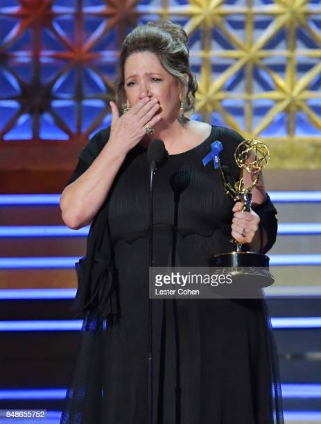 Actor Ann Dowd accepts the Outstanding Supporting Actress in a Drama Series award for 'The Handmaid's Tale' onstage during the 69th Annual Primetime...
