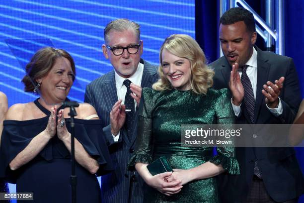 Actor Ann Dowd Executive Producer Warren Littlefield and actors Elisabeth Moss and O T Fagbenle accept the award for 'Program of the Year' for 'The...