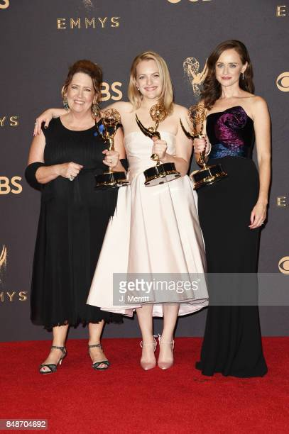 Actor Ann Dowd, winner of Outstanding Supporting Actress in a Drama Series; actor Elisabeth Moss, winner of Outstanding Lead Actress in a Drama...