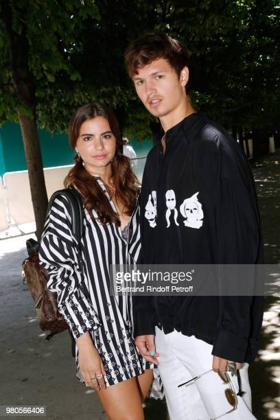 Actor Ansel Elgort and guest attend the Louis Vuitton Menswear Spring/Summer 2019 show as part of Paris Fashion Week on June 21 2018 in Paris France