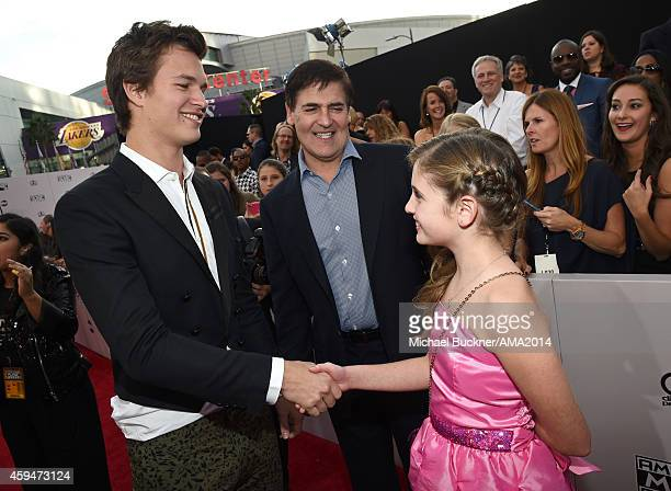 Actor Ansel Elgort entrepreneur Mark Cuban and Alyssa Cuban attends the 2014 American Music Awards at Nokia Theatre LA Live on November 23 2014 in...