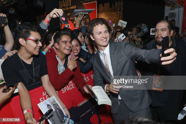 Actor Ansel Elgort signs autographs and takes selfies with fans during the 'Baby Driver' Mexico City premier at Cinemex Antara Polanco on July 26...