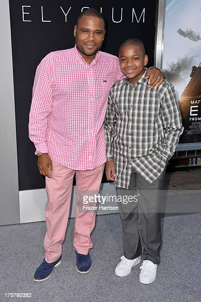 Actor Anthony Anderson and his son Nathan arrive at the premiere of TriStar Pictures' Elysium at Regency Village Theatre on August 7 2013 in Westwood...