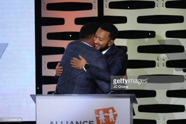 Actor Anthony Anderson and recording artist John Legend seen onstage during The Alliance For Children's Rights 28th Annual Dinner Honoring Karey...