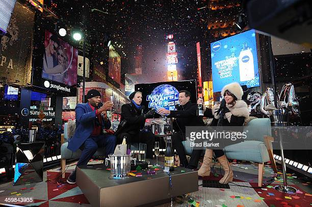 Actor Anthony Anderson Jane Lynch Carson Daly and Natasha Leggero celebrate the the bringing in of the year 2014 at the New Year's Eve 2013 With...