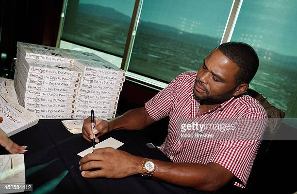 Actor Anthony Anderson signs autographs at Chicken Soup for the Soul's celebration of its latest book titles pet food line and more on July 23 2014...