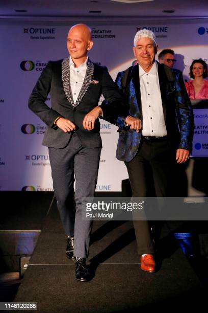 Actor Anthony Carrigan and Optune Patient Ambassador Brian Biggs walk the runway during the Creative Coalition's 2019 #RightToBearArts Gala Presented...