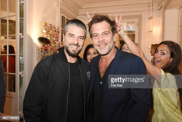 Actor Anthony Dupray TV presenter Ronald Guintrange and actress Emmanuelle Boidron attend the 'Love EtcÉ' Caroline Faindt Exhibition Preview at '28...