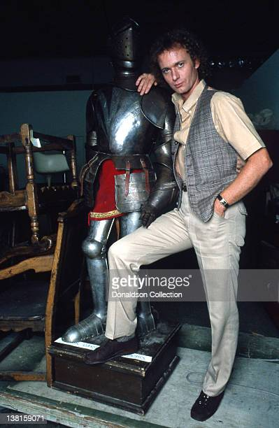Actor Anthony Geary poses for a portrait next to a knight in armour in circa 1990 in Los Angeles California
