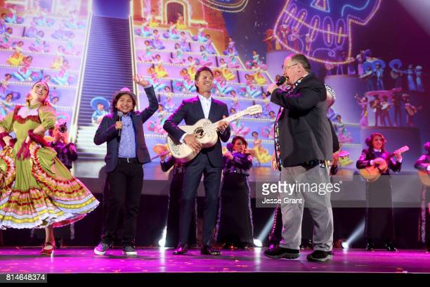 Actor Anthony Gonzalez and musician Federico Ramos of COCO and Chief Creative Officer of Pixar and Walt Disney Animation Studios John Lasseter took...