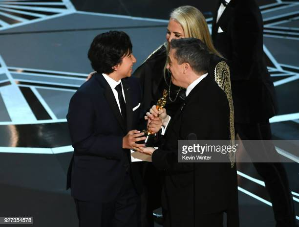 Actor Anthony Gonzalez codirector Lee Unkrich and producer Darla K Anderson accept Best Animated Feature Film for 'Coco' onstage during the 90th...