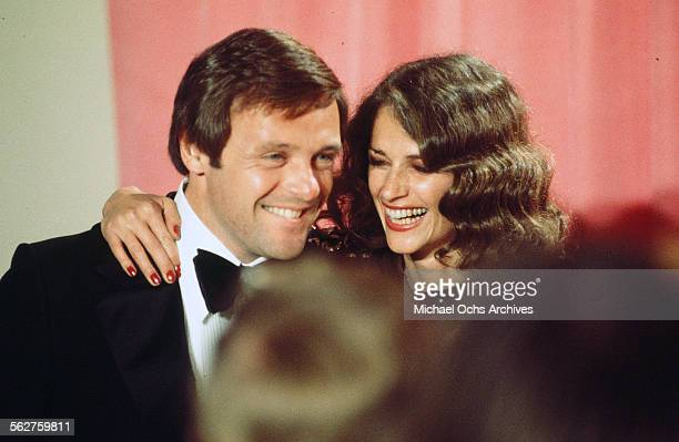 Actor Anthony Hopkins and actress Charlotte Rampling poses backstage during the 48th Academy Awards at Dorothy Chandler Pavilion in Los...