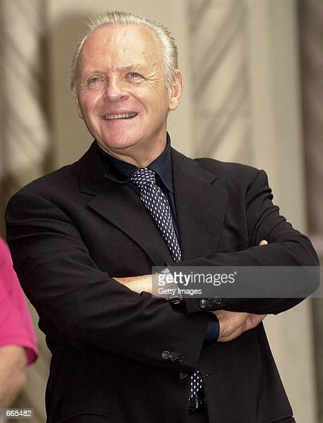 Actor Anthony Hopkins watches October 06 2000 as actress Winona Ryder is honored with a star on the Hollywood Walk of Fame in Hollywood CA