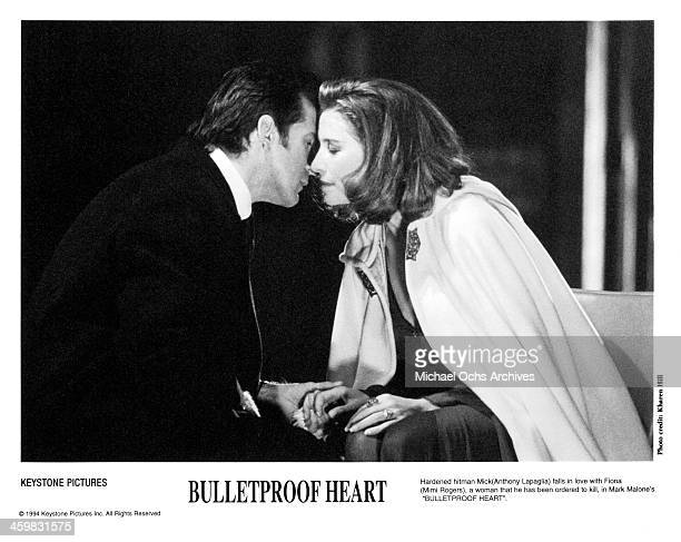 Actor Anthony LaPaglia and actress Mimi Rogers on set of the movie Killer aka Bulletproof Heart circa 1994