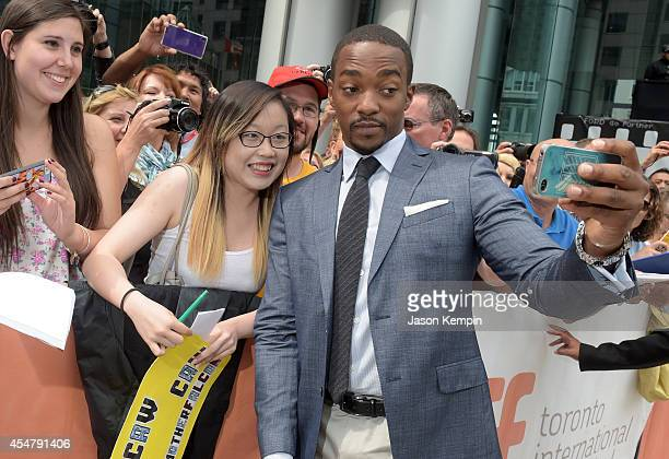 Actor Anthony Mackie greets fans at the Black And White premiere during the 2014 Toronto International Film Festival at Roy Thomson Hall on September...
