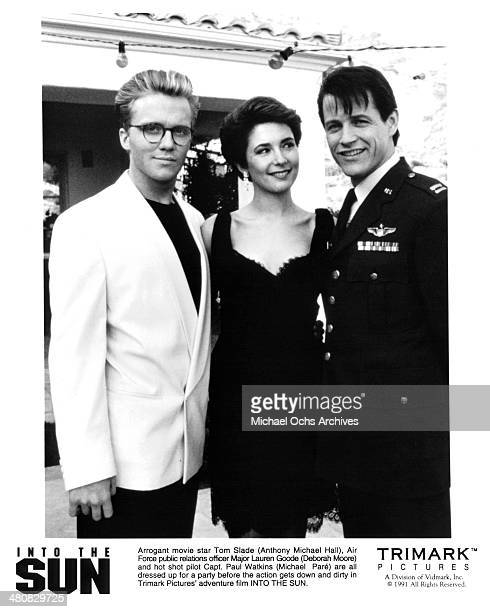 Actor Anthony Michael Hall actress Deborah Moore and actor Michael Pare pose for the Trimark movie ' Into the Sun ' circa 1992