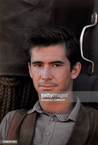 Actor Anthony Perkins poses for a portrait on the set of the film 'Tin Star' in 1957 in Los Angeles California
