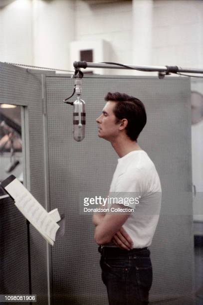 Actor Anthony Perkins records a song in the studio circa 1957 in Los Angeles California