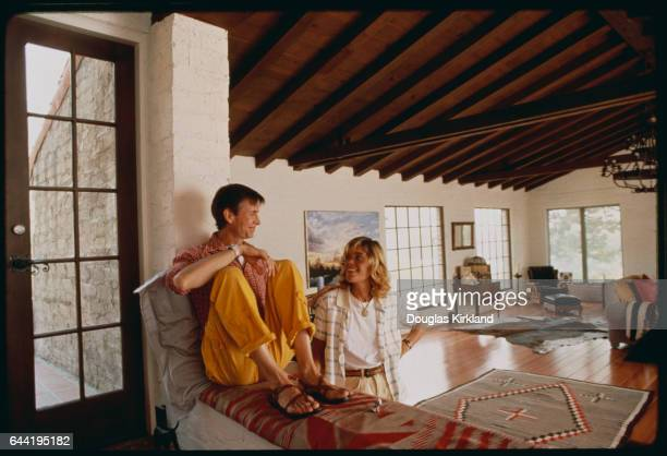 Actor Anthony Perkins who is best known for his role as Norman Bates in the 1960 Alfred Hitchcock thriller Psycho sits near his wife Berry Berenson...