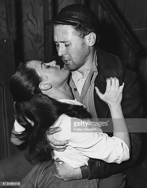 Actor Anthony Quayle and actress Mary Ure rehearsing a love scene from Arthur Miller's play A View From a Bridge at the Comedy Theatre, London, 1956.