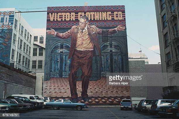 Actor Anthony Quinn is depicted in a huge mural advertising the Victor Clothing Company in Los Angeles California USA January 1990 Titled 'The Pope...