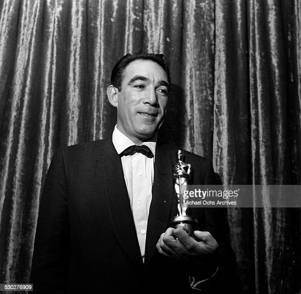 Actor Anthony Quinn pose with his Oscar for Best Supporting Actor for Lust for Life during the Academy Awards in Los AngelesCA