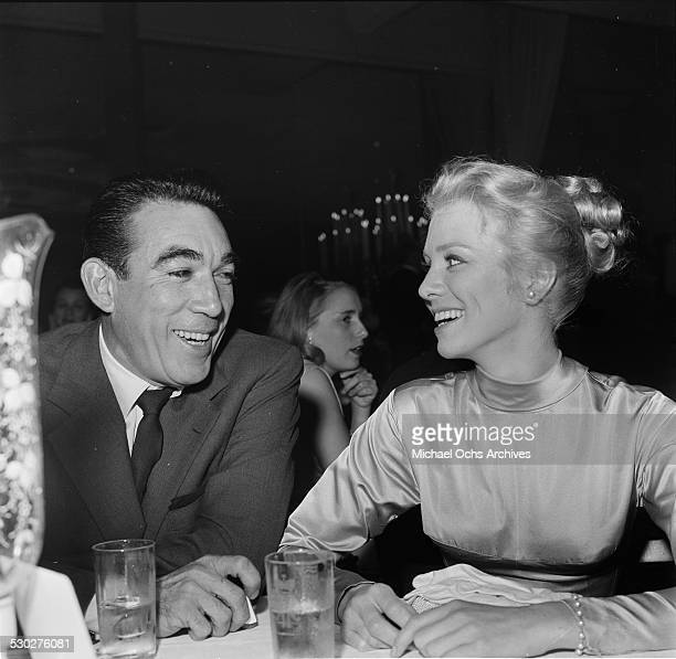 Actor Anthony Quinn talks with Tex Ritter's wife Dorothy Fay during the Cinema Editors Awards in Los AngelesCA