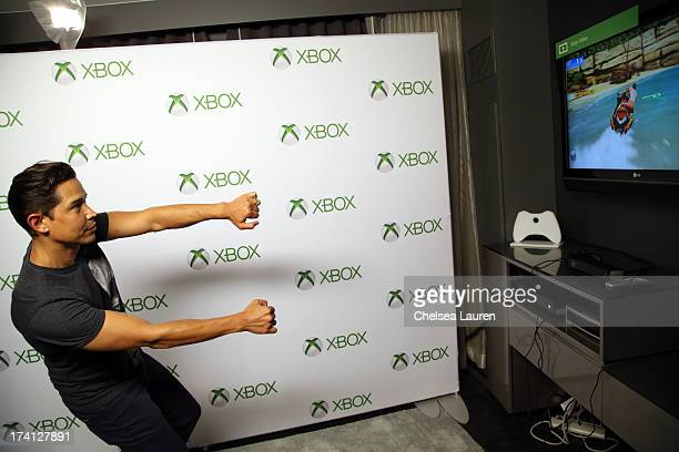 Actor Anthony Ruivivar plays Xbox One at ComicCon 2013 at the Hard Rock Hotel San Diego on July 20 2013 in San Diego California