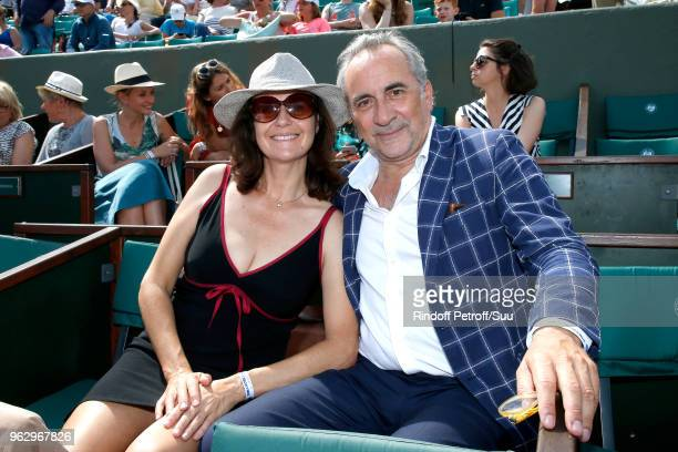 Actor Antoine Dulery and his wife Pascale Pouzadoux attend the 2018 French Open Day One at Roland Garros on May 27 2018 in Paris France