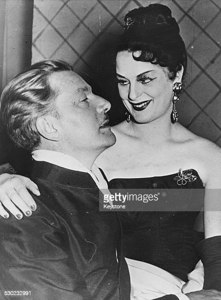 Actor Anton Walbrook with actress Elisabeth Wiedemann sitting on his lap at an event is Dusseldorf Germany September 24th 1951
