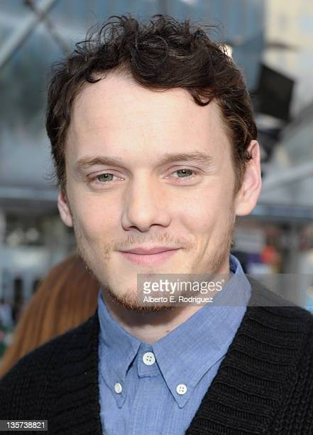 Actor Anton Yelchin attends a hand and footprint ceremony Immortalizing The Smurfs at Grauman's Chinese Theatre on December 13, 2011 in Hollywood,...