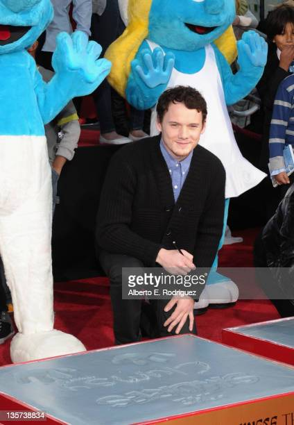 Actor Anton Yelchin attends a hand and footprint ceremony Immortalizing The Smurfs at Grauman's Chinese Theatre on December 13 2011 in Hollywood...