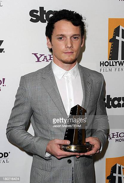 Actor Anton Yelchin poses with the Hollywood Spotlight Award backstage during the 15th Annual Hollywood Film Awards Gala Presented By Starz held at...