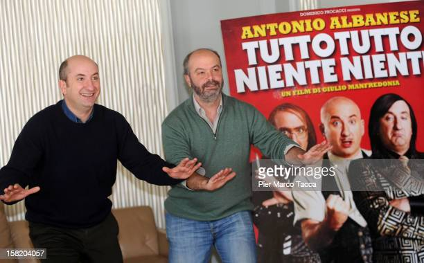 Actor Antonio Albanese and Director Giulio Manfredonia attend 'Tutto Tutto Niente Niente' photocall on December 11, 2012 in Milan, Italy.