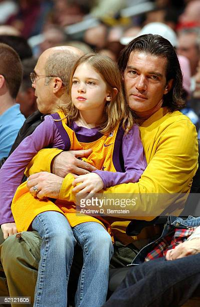 Actor Antonio Banderas and daughter Stella sit courtside as the Los Angeles Lakers take on the Portland Trail Blazers on February 1 2005 at the...