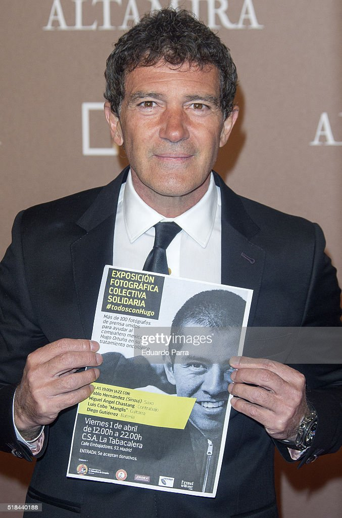 Actor Antonio Banderas attends 'Altamira' premiere photocall at Callao cinema on March 31, 2016 in Madrid, Spain. Antonio Banderas poses with the #todosconHugo poster exhibition. This photo exhibition is organized by Spanish photographers to help fellow Mexican Hugo Ortuño. Ortuño is ill with cancer and needed money to pay for their treatment.