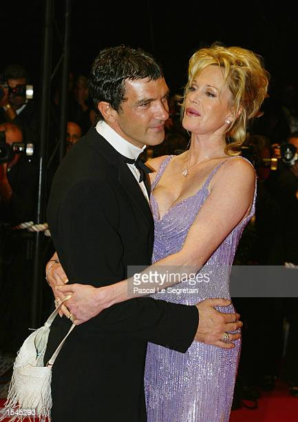 """Actor Antonio Banderas hugs his wife actress Melanie Griffith as they arrive for the screening of Brian de Palma's film """"Femme Fatale"""" at the 55th..."""