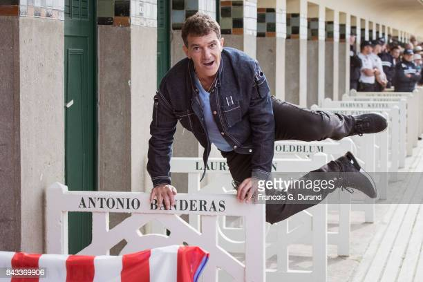 DEAUVILLE FRANCE SEPTEMBER Actor Antonio Banderas poses in front of his dedicated beach locker room on the Promenade des Planches during the 43rd...