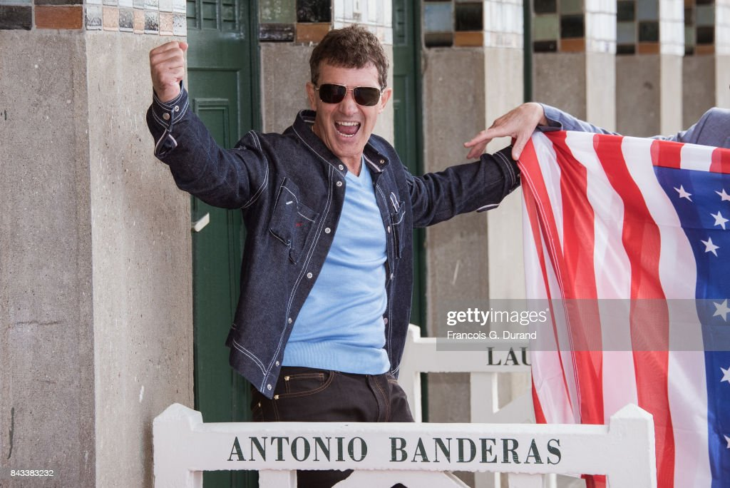 Actor Antonio Banderas poses in front of his dedicated beach locker room on the Promenade des Planches during the 43rd Deauville American Film Festival on September 6, 2017 in Deauville, France.
